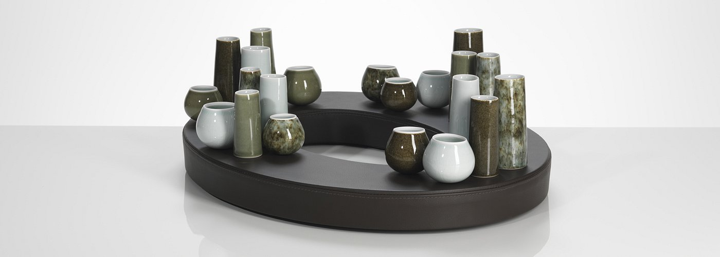 Extracurricular abode of stones iii comprising 21 pots and oval leather base.